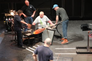 Lino Tagliapietra and tema at a demonstration in Corning Museum of Glass Amphiteater